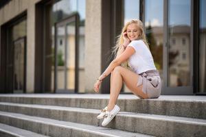 Blonde Girl Smiling Sitting On Stairs 8k Wallpaper