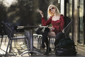 Blonde Girl With Shades Using Phone