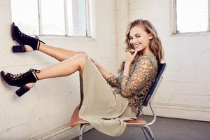 Blonde Hair Girl Sitting On Chair Smiling 5k