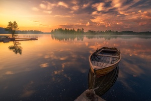 Boat In Silent Lake Nature Sunset