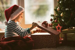 Boy Opening Christmas Present Wallpaper