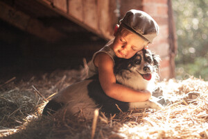 Boy Outdoors Hugging Dog 5k Wallpaper