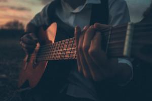 Boy Playing Guitar Outdoors 5k