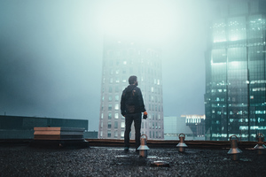Boy Standing On Building Roof 4k Wallpaper