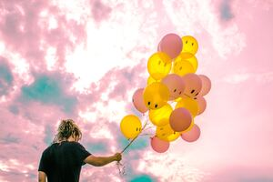 Boy With Happy And Sad Balloons