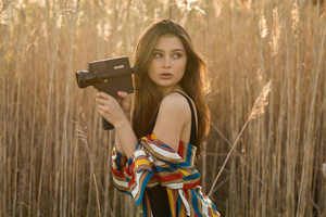 Brunette Girl In Field With Camera Wallpaper