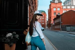 Brunette Wearing Baseball Cap Looking Back