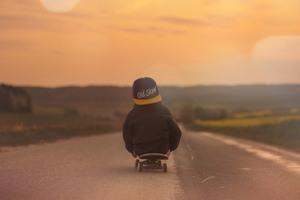 Children Riding Skatebaord Wallpaper