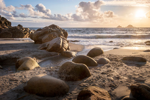 Coast Stones Sand Sunrise 4k Wallpaper