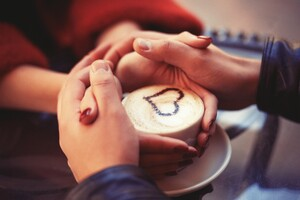Couple Holding Hands At Coffee
