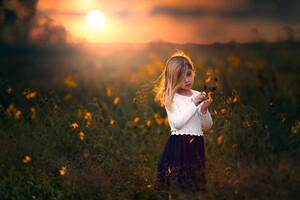 Cute Child Girl With Flowers Outdoors Wallpaper