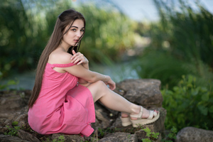 Cute Girl Sitting On Rock In Pink Dress Looking At Viewer 8k Wallpaper