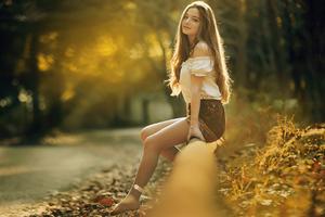 Cute Girl Sitting Roadside Pipe 4k Wallpaper