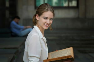 Cute Girl Smiling Book In Hand