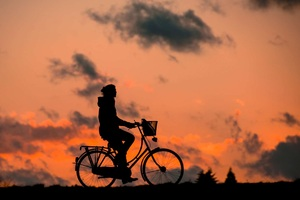 Cyclist Chasing Sky Wallpaper