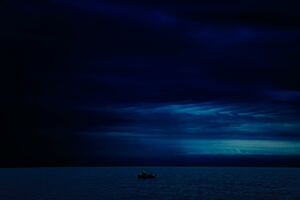 Dark Evening Blue Cloudy Alone Boat In Ocean 5k
