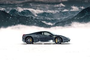 Ferrari In Snow 5k Wallpaper
