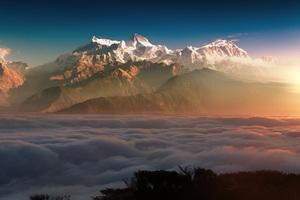 First Light Of Sun On Mountains Wallpaper