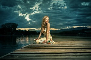 Girl Alone Sitting Near Lake Wallpaper