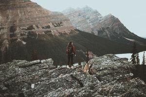 Girl At Tip Of Mountain