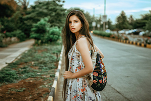 Girl Backpack Outdoors Looking Back 4k Wallpaper