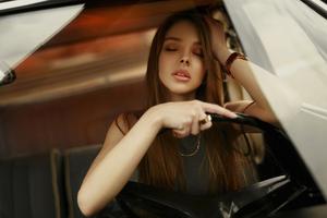 Girl Closed Eyes In Car 4k Wallpaper