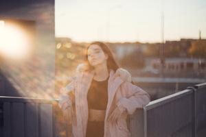 Girl Closed Eyes Sunbeam On Face Wallpaper
