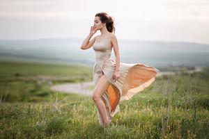 Girl Dress Wind Blowing Field 4k Wallpaper