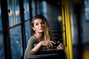 Girl In Bus Sitting Looking Back 4k Wallpaper
