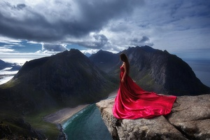 Girl In Red Dress Standing On The Edge Of Mountain Cliff Wallpaper