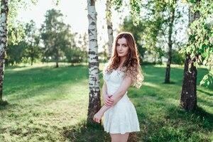 Girl In White Dress Outdoors