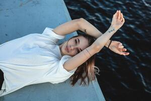 Girl In White Shirt Lying Down 5k Wallpaper