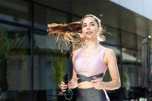 Girl Jogging Ponytail Earphones