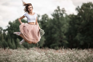 Girl Jumping Field 4k Wallpaper