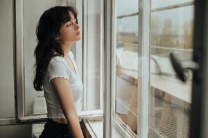 Girl Looking Outside Window 5k Wallpaper