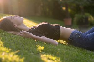 Girl Lying Down Back Grass 8k Wallpaper