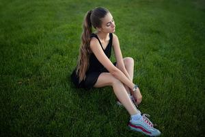 Girl Model Sitting On Grass Long Hair 4k Wallpaper