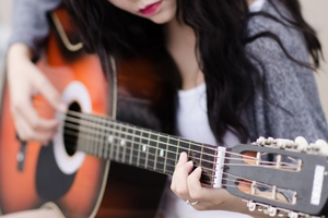 Girl Playing Guitar Wallpaper