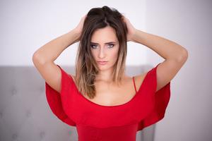 Girl Red Dress Hands In Back 5k Wallpaper