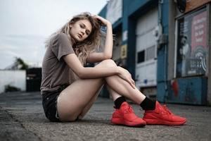 Girl Sitting Athletic Shoes 4k Wallpaper