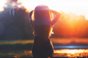 Girl Sitting Back View Lens Flare 4k Wallpaper