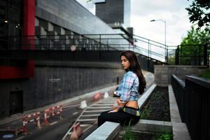 Girl Sitting City Outdoor 5k Wallpaper