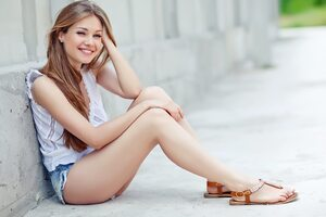 Girl Sitting On Floor Smiling