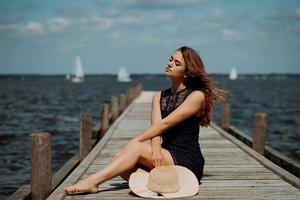 Girl Sitting On Pier Side Depth Of Field Wallpaper