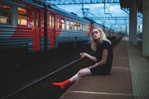 Girl Sitting On Platform Smoking 5k Wallpaper