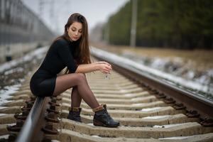 Girl Sitting On Railway Line 4k