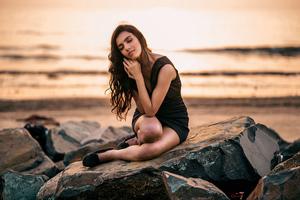 Girl Sitting On Rock Nature 4k Wallpaper