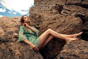 Girl Sitting On Rocks 4k Wallpaper