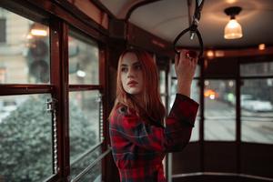 Girl Standing In Tram 8k Wallpaper
