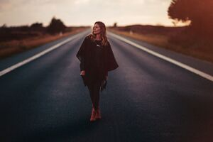Girl Standing On Road 5k Wallpaper
